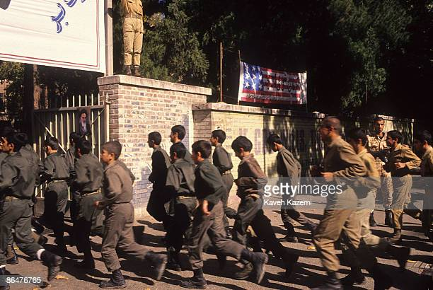 Iranian trainee Revolutionary Guards or 'Pasdaran' march into the compound of the former US embassy in Tehran 25th September 1994 After the seizure...
