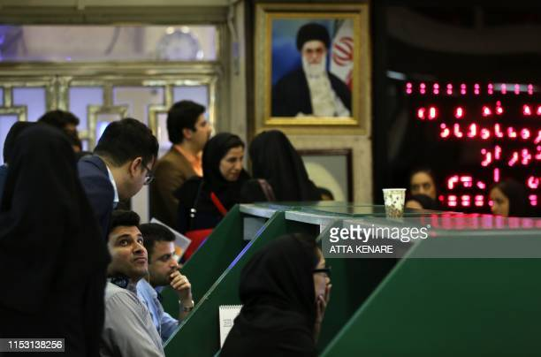 Iranian treaders work at Tehran Stock Exchange on July 1 2019 Iran's stock market is thriving despite US sanctions which have battered its economy...