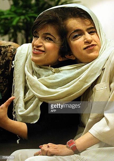 Iranian twins Ladan and Laleh Bijani give a press conference at Raffles Hospital in Singapore 11 June 2003 Displaying a defiant optimism the...