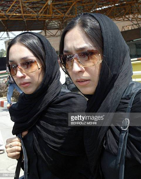 Iranian twins Leila and Maryam friends of the late fellow Iranian twins Laleh and Ladan Bijani attend a ceremony held at Tehran's Mehrabad airport...