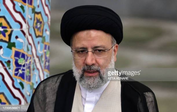 Iranian ultraconservative cleric and presidential candidate Ebrahim Raisi gives a news conference after voting in the presidential election, at a...