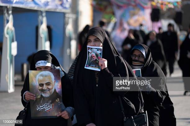 Iranian veiled women carrying portraits of the Former Islamic Revolutionary Guards Corps Qods Force Qasem Soleimani during a rally to mark the...