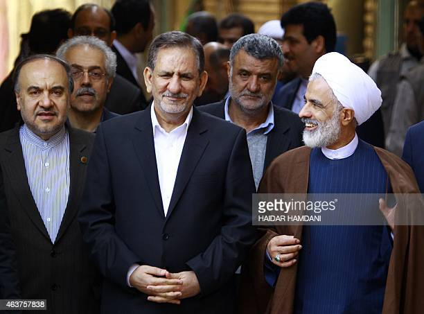 Iranian VicePresident Eshaq Jahangiri walks with Shiite Muslim scholar Mohammed Said alHakim before meeting with Iraq's top Shiite cleric Grand...