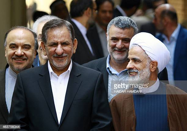 Iranian Vice-President Eshaq Jahangiri walks with Shiite Muslim scholar Mohammed Said al-Hakim before meeting with Iraq's top Shiite cleric Grand...