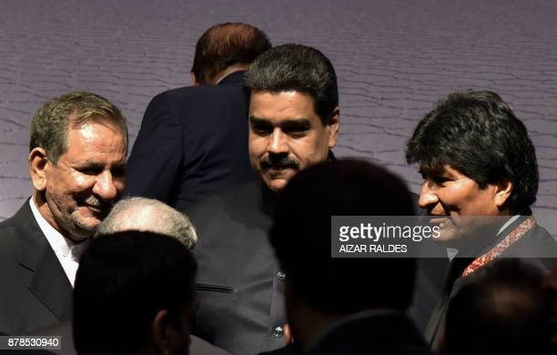 Iranian VicePresident Eshaq Yahanguiri Venezuelan President Nicolas Maduro and Bolivian President Evo Morales speak during IV Gas Exporting Countries...