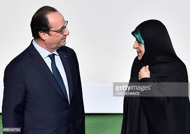 Iranian VicePresident Masoumeh Ebtekar is welcomed by French President Francois Hollande upon her arrival for the opening of the UN conference on...