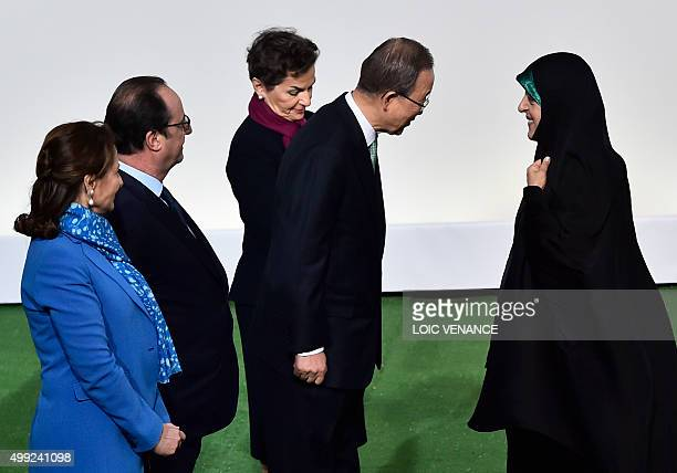 Iranian VicePresident Masoumeh Ebtekar is welcomed by United Nations Secretary General Ban Kimoon Executive Secretary of the UN Framework Convention...