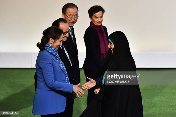 Iranian VicePresident Masoumeh Ebtekar shakes hands with French Minister of Ecology Sustainable Development and Energy Segolene Royal upon her...