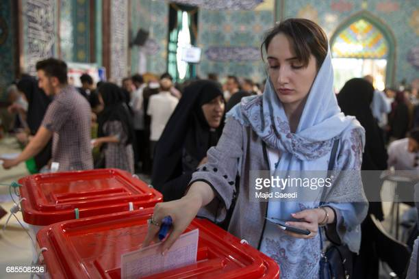 Iranian voters cast their ballots for the presidential and municipal council election on May 19, 2017 in the city of Qom, south of the capital...
