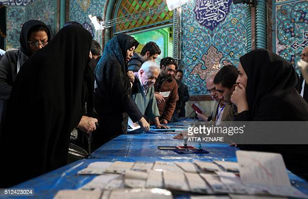 Iranian voters queue to cast their vote for both parliamentary elections and the Assembly of Experts at polling station in Tehran on February 26 2016...