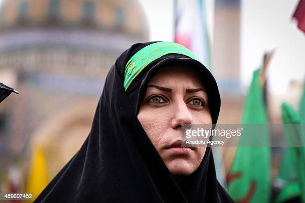 Iranian woman attends the celebrations marking the 35th anniversary of the Basij , a paramilitary volunteer militia established in 1979 by order of...