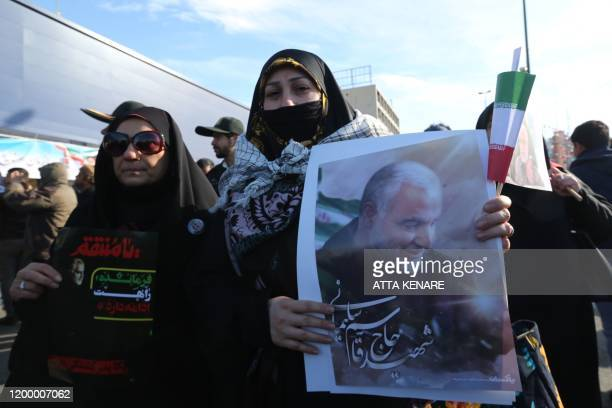 A Iranian woman carries a portrait of slain Iranian General Qasem Soleimani on the 40th day of his killing in a US drone strike during commemorations...