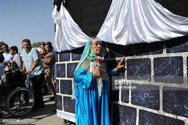 Iranian woman circles a makeshift Kaaba to reenact part of the Hajj pilgrimage as Iranians marked the Eid AlAdha Islamic 'Feast of the Sacrifice'...