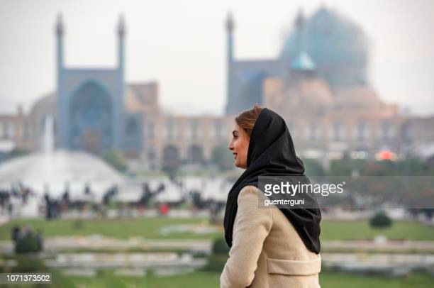 Iranian woman in front of Shah Mosque, Isfahan