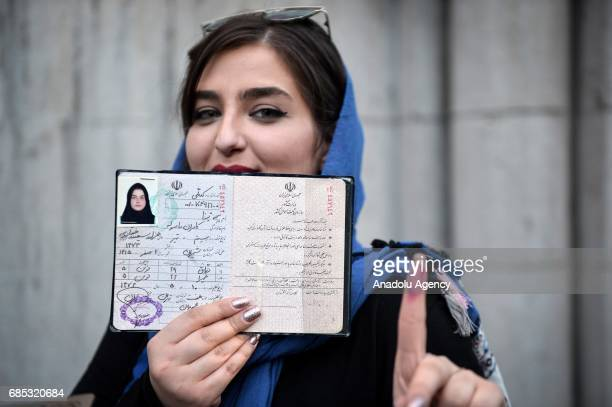 Iranian woman poses for a photo before she casts her ballot at Husayiniyahyi Irshad mosque during Iran's 12th presidential election in Tehran Iran on...