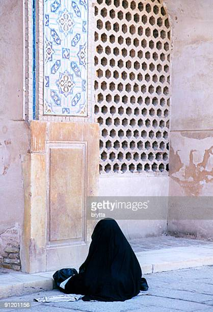 Iranian woman praying outside the Friday mosque,Isfahan.
