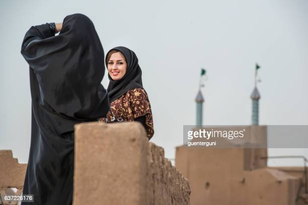 iranian woman taking a photo of her friend, yazd, iran - iranian culture ストックフォトと画像