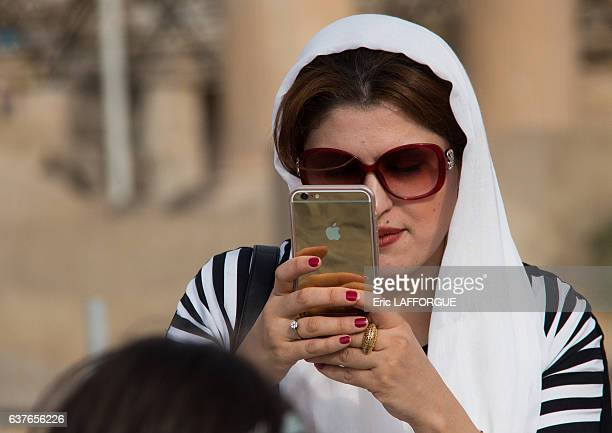 Iranian woman taking pictures with an iphone in the Central District on September 11, 2015 in Tehran, Iran.