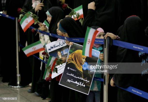 Iranian women and children greet Journalist Marzieh Hashemi as she arrives at Tehran Imam Khomeini International Airport in Tehran on January 30 2019...