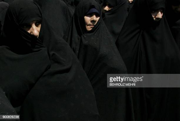 Iranian women attend a demonstration to protest against women who violate the strict Islamic dresscode after the Friday prayers in Tehran 20 April...
