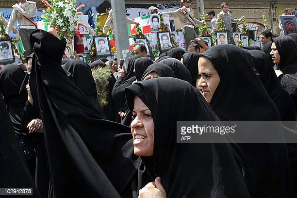 Iranian women attend the mass funeral of those killed in twin suicide bombings targeting a Shiite mosque in the southeastern Iranian city of Zahedan...