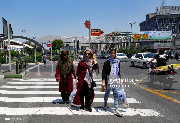 Iranian women carry their shopping bags as they cross a road in the Iranian capital Tehran on June 15 2019 US President Donald Trump last year...