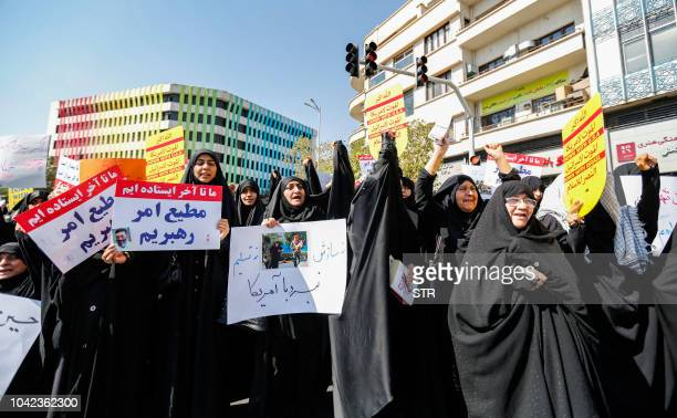 Iranian women chant slogans and raise signs during an antiUS demonstration following the weekly Muslim Friday prayer in the capital Tehran on...