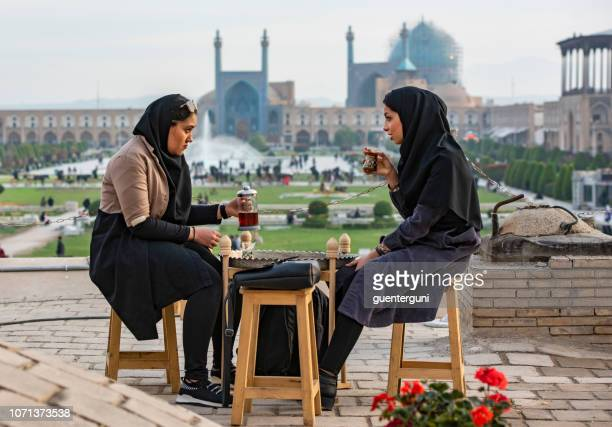 iranian women drinking tea in front of shah mosque, isfahan - isfahan province stock pictures, royalty-free photos & images