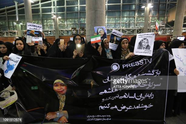Iranian women greet Journalist Marzieh Hashemi as she arrives at Tehran Imam Khomeini International Airport in Tehran on January 30 2019 The USborn...