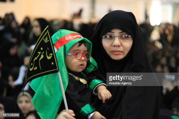 Iranian women holding their babies in their arms participate in the Day of Ali Asghar on the first Friday of Muharram the first month of the Islamic...