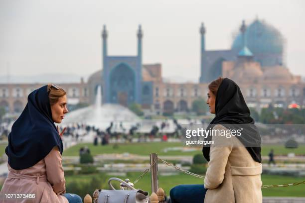 Iranian women in front of Shah Mosque, Isfahan