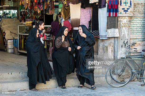 iranian women in the imperial bazaar of isfahan, iran - iranian culture stock photos and pictures