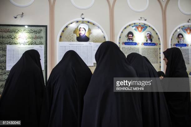 Iranian women line up to vote for both parliamentary elections and the Assembly of Experts at a polling station at the Massoumeh shrine in the holy...