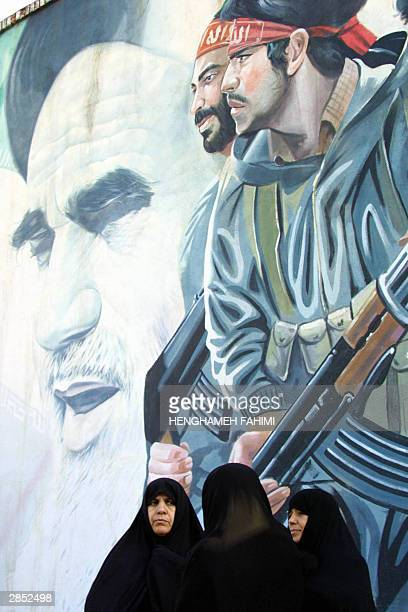Iranian women listen to a speech on Khaled Eslamboli in front of a mural of late founder of the Islamic Republic Aytotollah Ruhollah Musawi Khomeini...