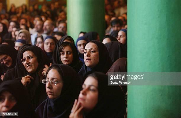 Iranian women listen to Ali Akbar Hashemi Rafsanjani frontrunner in Iran's upcoming presidential election speak to supporters at the Jamaran Mosque...