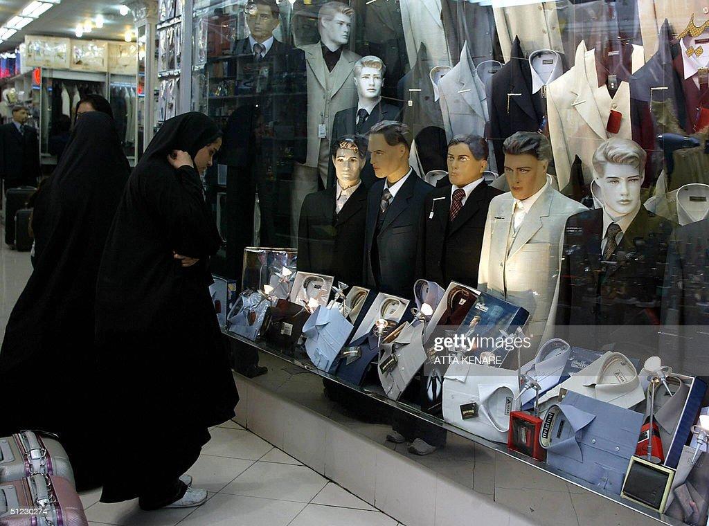 5ca7f13e6 Iranian women look at a shop window in Tehran 28 August 2004. Window ...