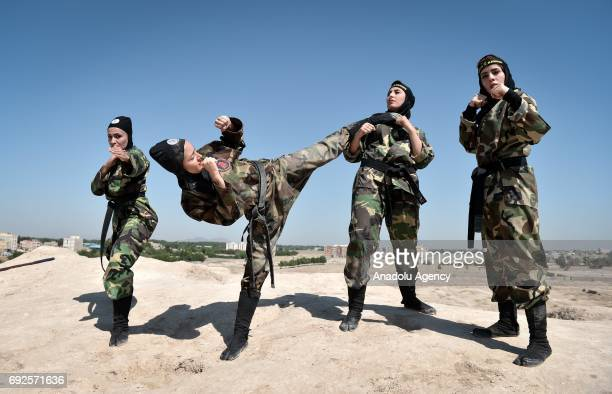 Iranian women perform as they train Far East Fighting Arts to be able to defend themselves, at the Jughin castle which is located 40 km's far from...