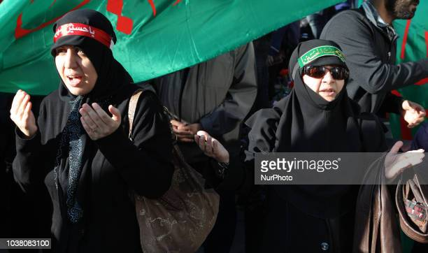 Iranian women pray as an Imam recites the details of the death of the third Imam Hussein during the holy month of Muharram in Toronto Ontario Canada...