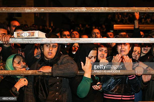 Iranian women pray for forgiveness as Balal an Iranian man who killed a fellow Iranian Abdolah Hosseinzadeh in a street fight with a knife in 2007 is...