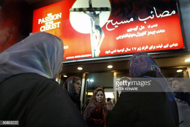 Iranian women queue outside a movie theatre in Tehran for the first screening of Mel Gibson's film The Passion of the Christ in Iran 05 May 2004...