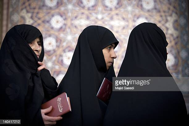 Iranian women queue outside to vote in a polling station at the Massoumeh shrine on March 2 2012 in the religious city 130 kms east of Tehran Qom...