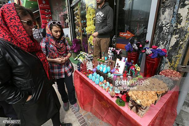 Iranian women shop for Noruz the Persian New Year at a market in Tehran on 19 March 2014 Iranians are preparing to celebrate Noruz an ancient...