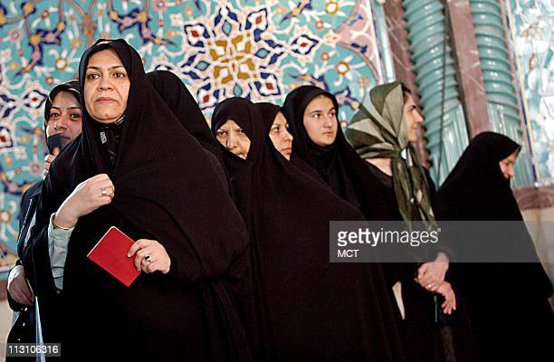TEHRAN IRAN Iranian women stand in line at a mosque in Tehran that was transformed into a polling station as they wait to cast their ballots in the...