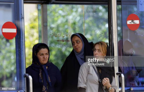 Iranian women wait for a bus in Tehran on June 8 2017 one day after twin attacks in the capital Iran said that the five Iranians who killed 17 people...