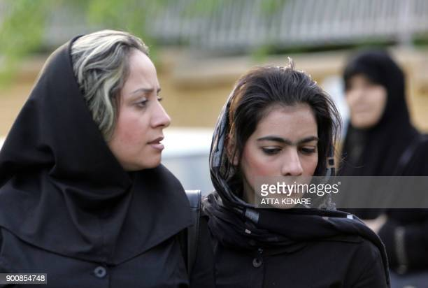 Iranian women walk in a street in Tehran 23 April 2007 Iran has issued more than a thousand warnings and arrested dozens in a new drive aimed at...