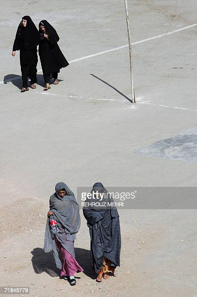 Iranian women walk in the courtyard of the Jamkaran mosque outside the religious city of Qom 120 kms south of Tehran 08 September 2006 Hundreds of...
