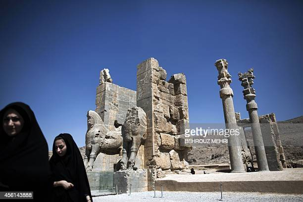 "Iranian women walk past the ""Gate of All Nations"" at the ancient Persian city of Persepolis near Shiraz in southern Iran on September 26, 2014...."