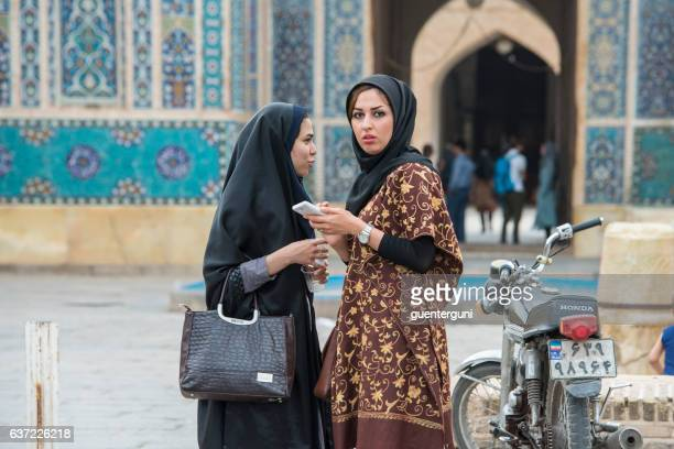iranian women with smartphone in front of jame mosque, yazd - iranian culture ストックフォトと画像