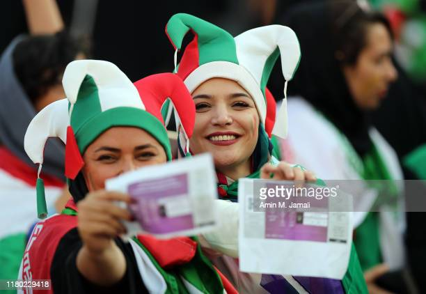 Iranian Women's fan show their tickets during the FIFA World Cup Qualifier match between Iran and Cambodia at Azadi Stadium on October 10, 2019 in...