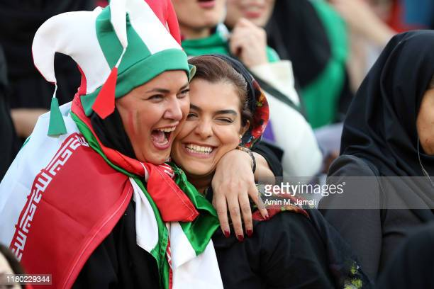 Iranian Women's fans smile during the FIFA World Cup Qualifier match between Iran and Cambodia at Azadi Stadium on October 10, 2019 in Tehran, Iran.